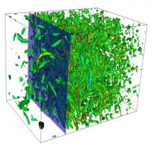 Snapshot of shock/turbulence interaction at M=2, Mt=0.15, Re_l = 40. The flow is from left to right, with the shock visualized by transparent isosurfaces of compression. Vortex cores are visualized by isosurfaces of the second invariant of the velocity gradient tensor, colored by the vorticity magnitude. See Larsson et al., CTR Annual Research Briefs 2007